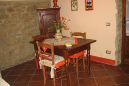 Woonkamer appartement Il Melograno