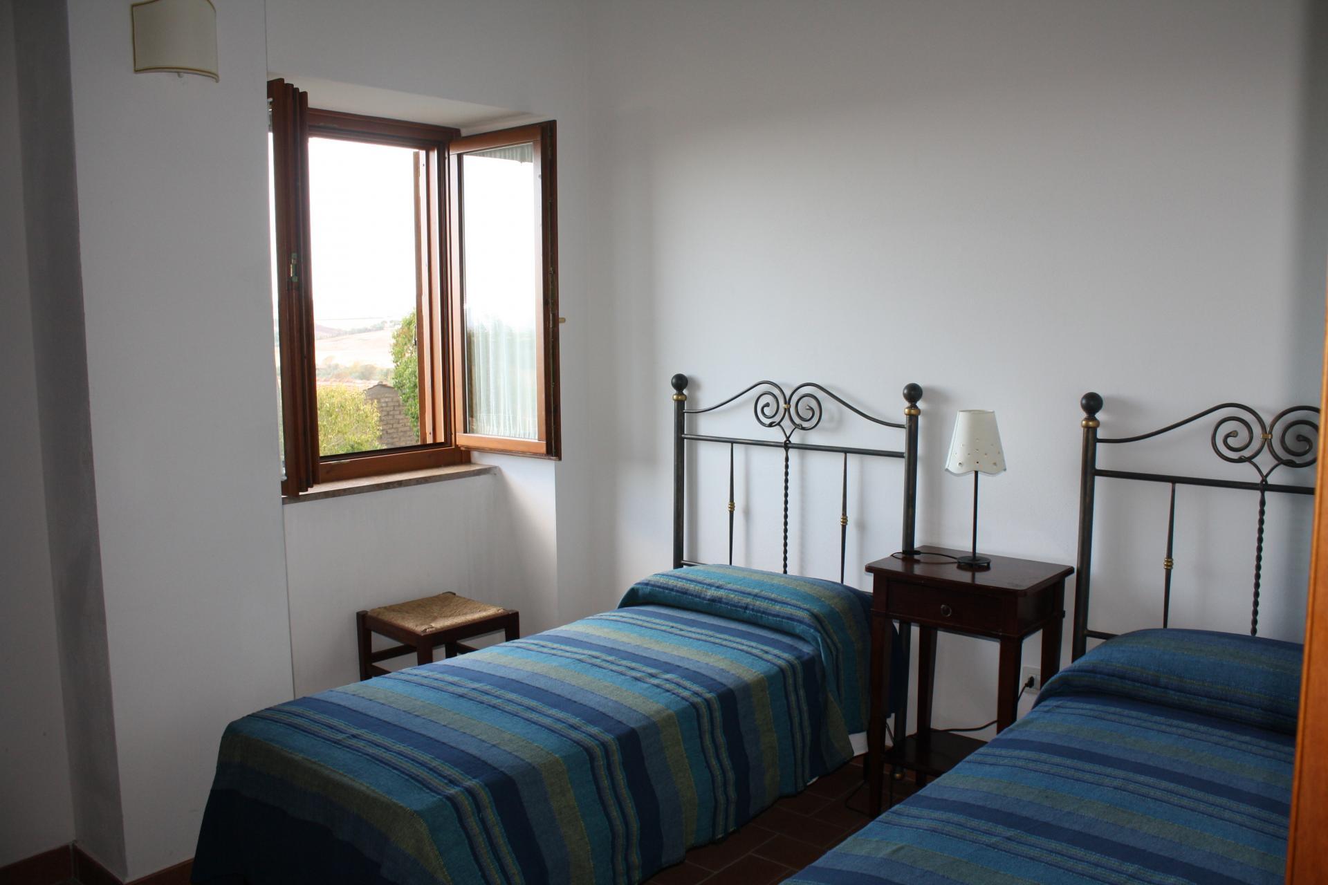 Slaapkamer Met 2 Eenpersoonsbedden.Alle Appartementen Beschikken Over Een Woongedeelte Met